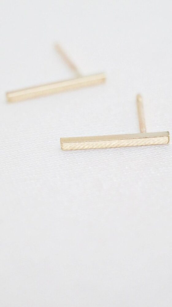 Ethically-made 9ct Gold classic bar studs on white background.