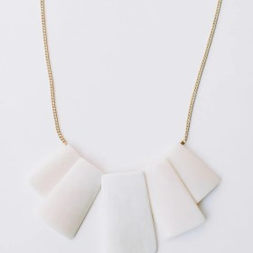 Voyage necklace made by upcycled rectangular bone spread out wonderfully as a pendant on a brass chain.