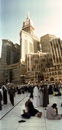 The Abraj Al-Bait Towers, overshadowing the small Kaaba.