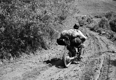 Transferring heavy loads on the motorcycle to Karangan Village