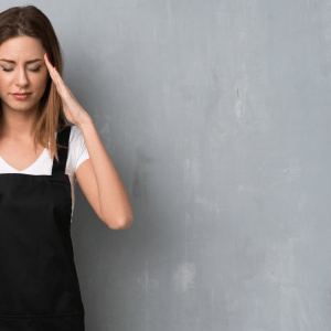 upset mother wearing an apron