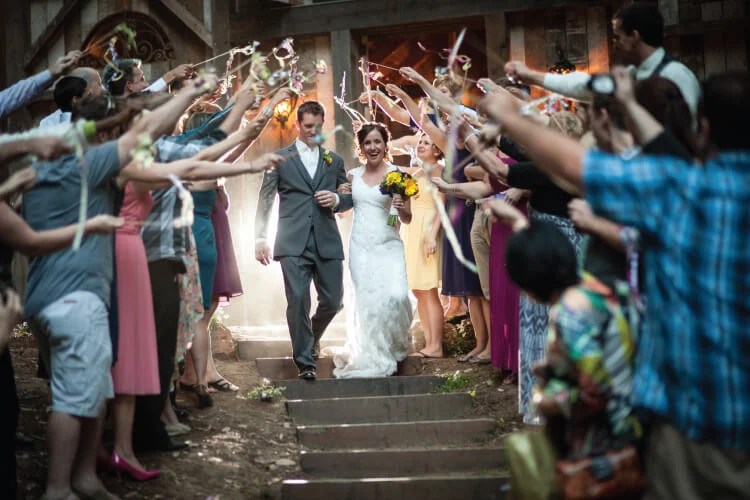 bride and groom send off with fabric wedding streamers