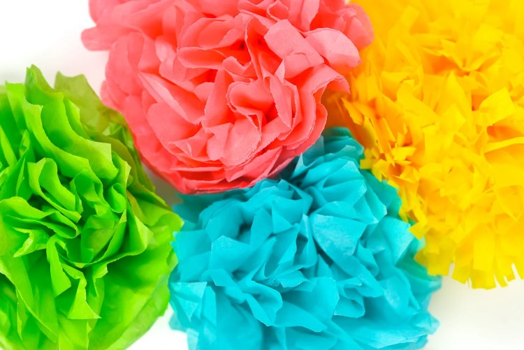 Tissue paper flowers make a gorgeous event decor with a big impact—think weddings, baby showers, bridal showers and more! Learn how to make easy tissue paper flowers, as well as different methods for cutting the petals to create four unique styles.