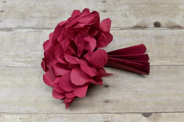 How to Make Tissue Paper Flowers Four Ways   Hey  Let s Make Stuff Fluffing a tissue paper flower  Tissue paper flowers make a gorgeous budget  wedding centerpiece