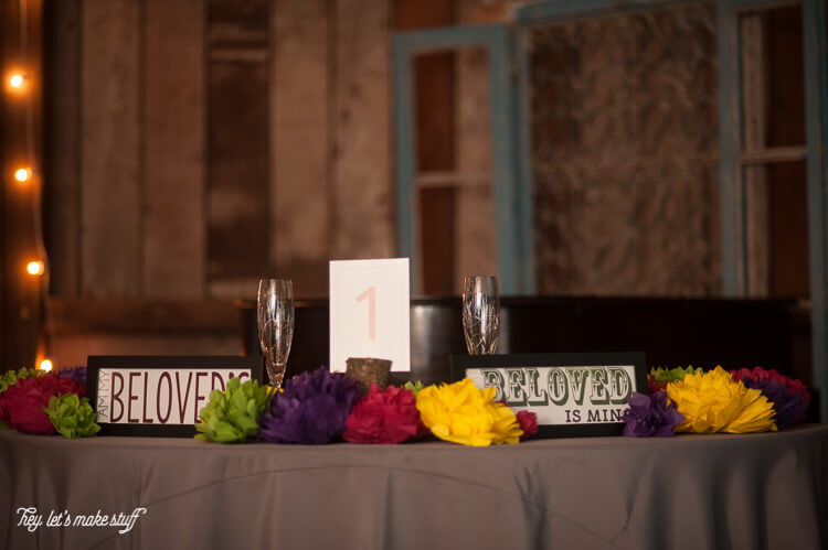 tissue paper flowers displayed on wedding table
