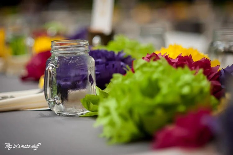 up close view of tissue paper flowers on as wedding centerpiece