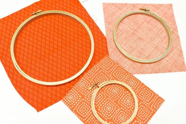 embroidery hoops on orange pumpkin fabric