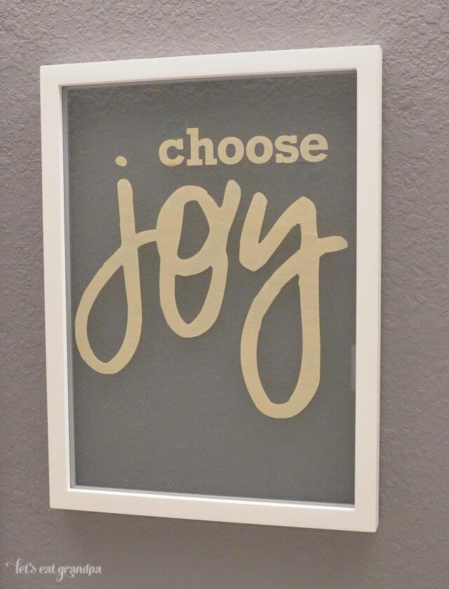 Choose joy floating artwork on wall