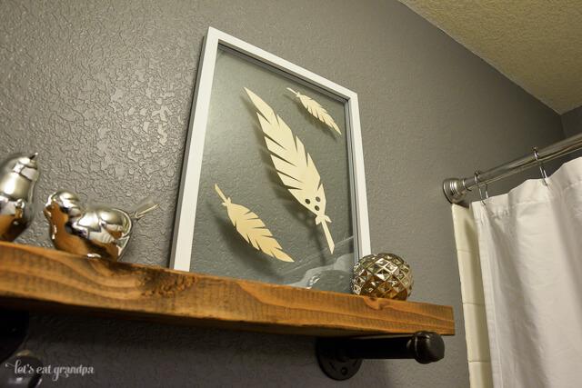feather floating artwork in bathroom