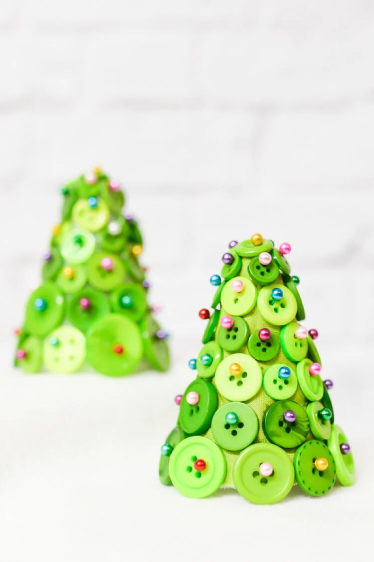 Buttons, straight pins, and foam cone equal an adorable and easy Christmas tree! A fun craft project to make your holidays special.