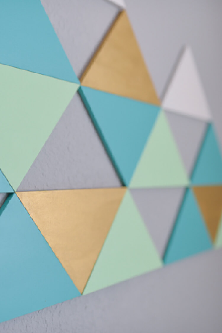 This cute geometric mountain wall art is made using MDF triangles in whatever color combination you'd like! Perfect for filling up large walls -- it's nearly six feet across!