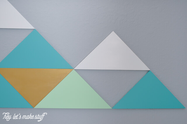 close up of DIY geometric mountains on wall