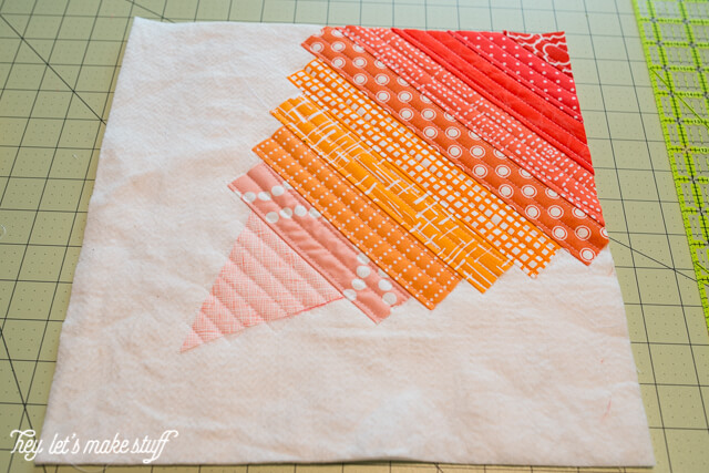 This Go Fly a Kite QAYG quilt block is perfect for a spring quilt! Includes the instructions to make this adorable quilt block.