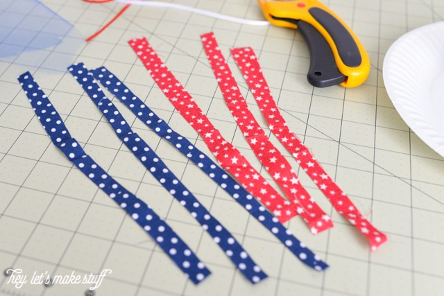 fabric strips cut on sewing mat with rotary blade