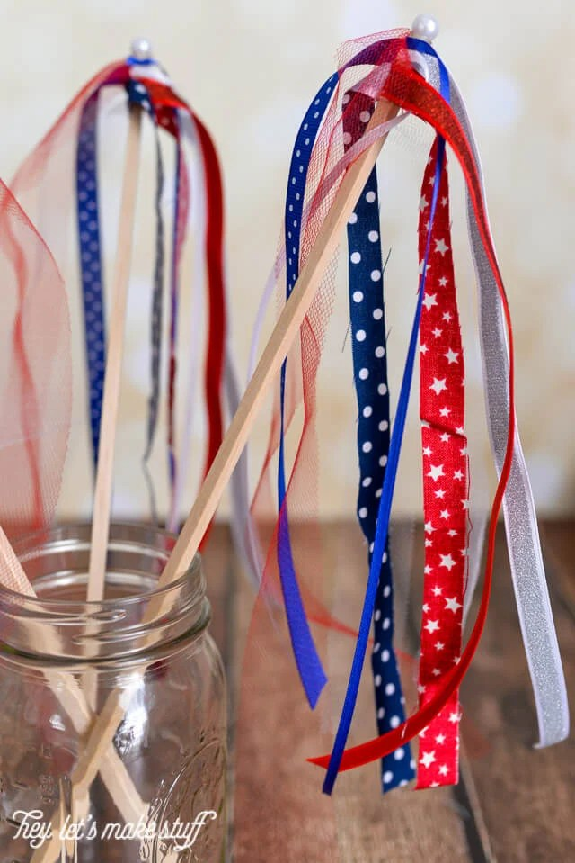 side view of finished red, white and blue DIY patriotic streamers in mason jar