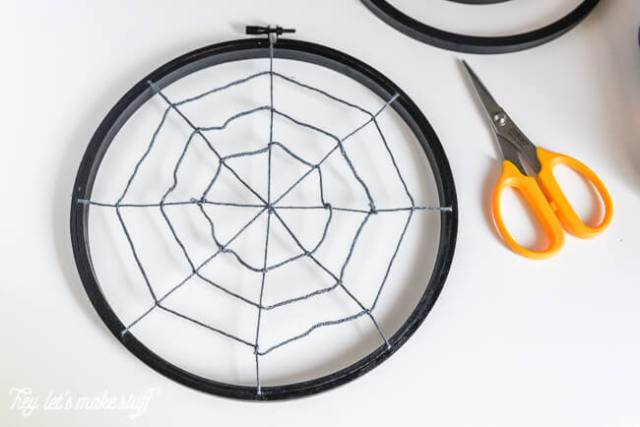Turn some simple craft supplies into spooky Halloween spider hoops!
