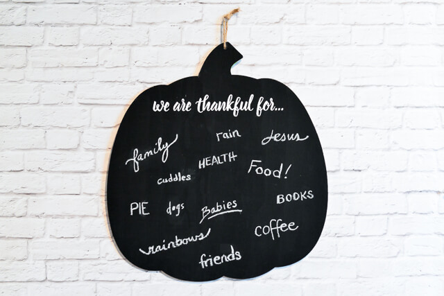 Make a gratitude chalkboard to give thanks! Write what you're thankful for on this cute pumpkin sign, and then snap a photo. Do it every year to have a record of what you're grateful for as the years go by.