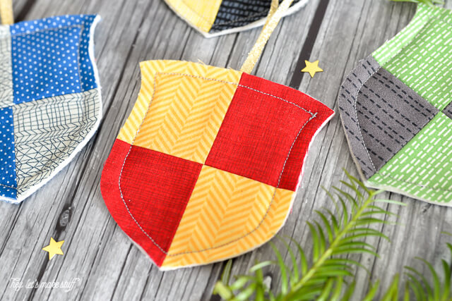 Decorate your Christmas tree, Hogwarts style. Make these simple raw-edge house crest ornaments for Gryffindor, Hufflepuff, Ravenclaw, and Slytherin. Perfect for every Harry Potter fan and an easy project for the beginning sewist.