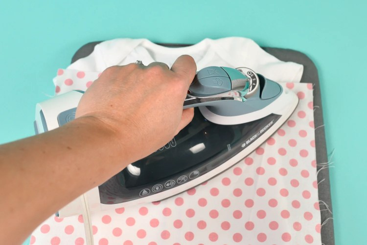 use a thin scrap of cotton on top of the plastic carrier sheet