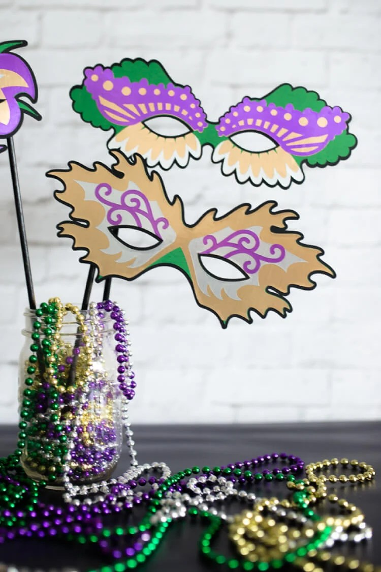 These Mardi Gras masks are perfect for a Fat Tuesday party -- either as part of a costume or as photo booth props. They even work as decorations because you can cut them any size you'd like on your Cricut.