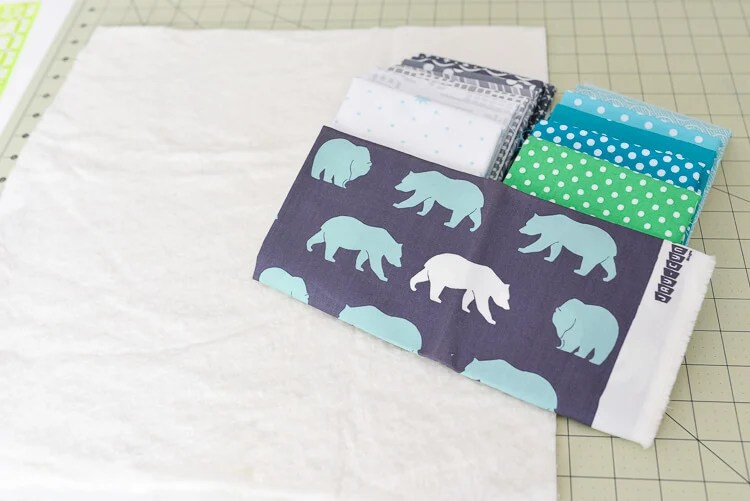 This Bear Mountain quilt-as-you-go (QAYG) block is a fun quilt block perfect for a mountain nursery or any woodland decor!