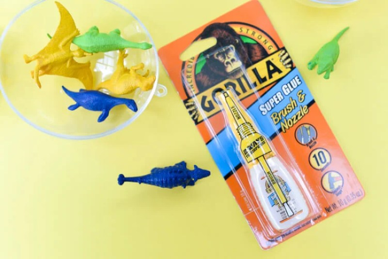 Make your own fun toddler sound shaker toys using plastic ornaments and Gorilla Glue! The possibilities are endless and my twins LOVED them. #GorillaTough #GorillaOfCourse #ad