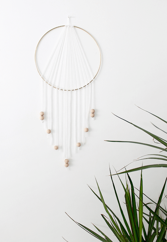 DIY Modern Dreamcatcher -- If you love the delicate, boho style of a dreamcatcher, here are 10+ dreamcatcher tutorials for you to try to make your own!