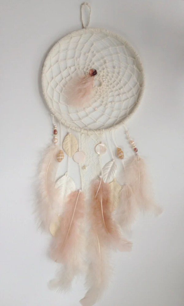 Pink Feathery Dreamcatcher -- If you love the delicate, boho style of a dreamcatcher, here are 10+ dreamcatcher tutorials for you to try to make your own!