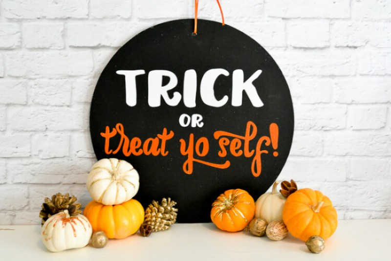 Get the free SVG cut files to make this hilarious Parks & Rec themed Halloween door sign!