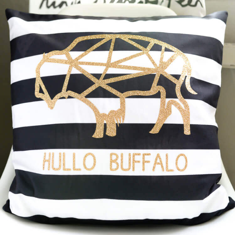 Use your Cricut Explore Air 2 to make this modern geometric buffalo pillow using glitter iron-on vinyl!