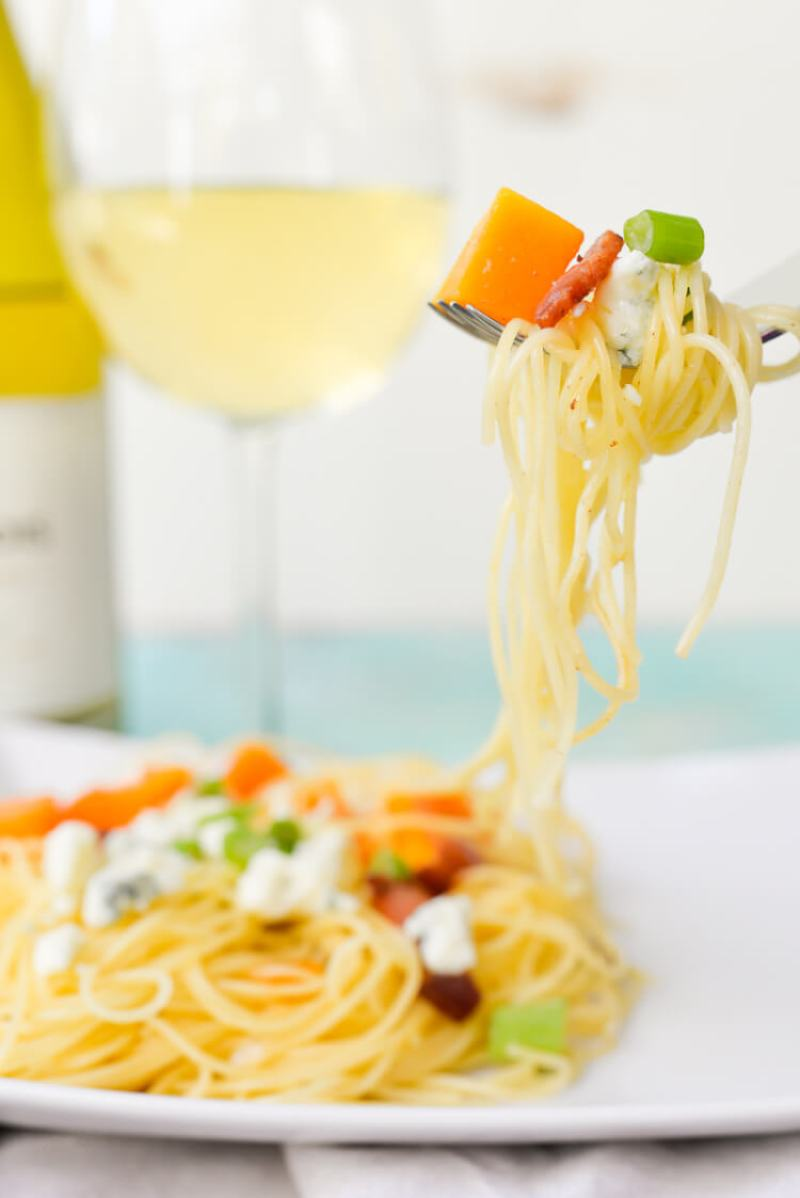This butternut squash angel hair pasta is a delicious and easy dinner recipe that is perfect for fall cooking. Pair it with a glass of chardonnay for a light fall meal.