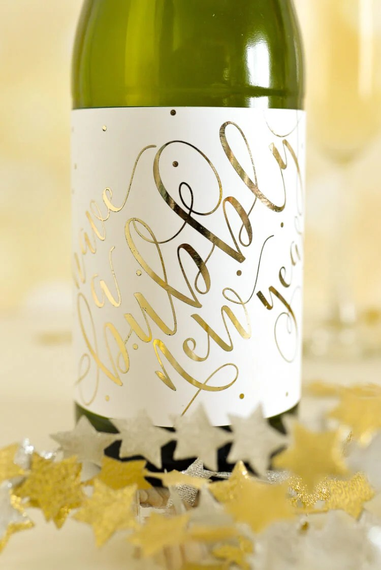 A champagne bottle decked with these cute foiled labels is the perfect hostess gift to bring to a New Year's Eve party!