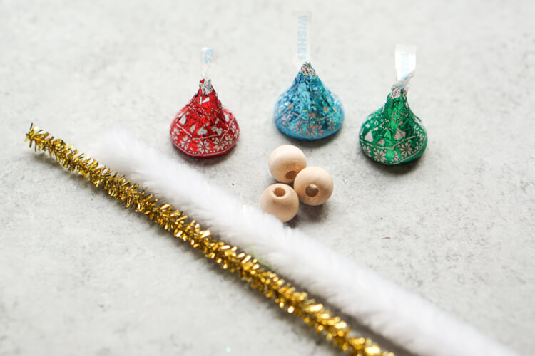 These Hershey's Kisses angels are even cuter because they are wearing Christmas sweaters! A cute craft that makes a perfect ornament, place card holder, or gift topper.
