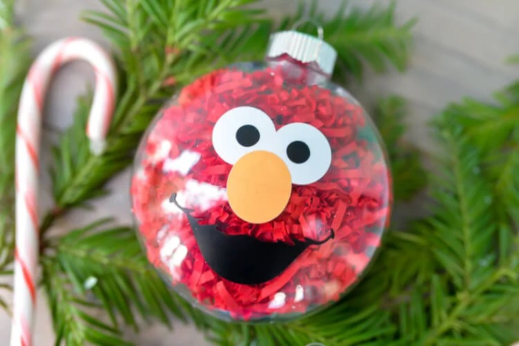 If your kids love Sesame Street, make these DIY Sesame Street Ornaments! They are a super easy Christmas craft and you'll love having Elmo and Cookie Monster on your Christmas Tree!