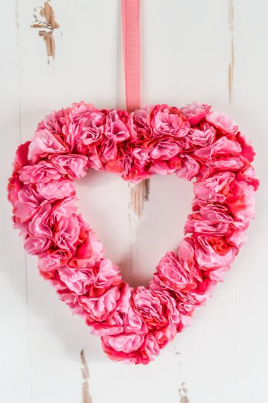 This beautiful tissue paper Valentine's Day wreath is deceptively simple to make! This easy paper craft is perfect for Valentine's Day decor or for a Valentine's Day party.