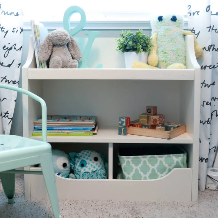 Skip the traditional nursery and create bold, bright feature wall! Here's how to paint a geometric wall in your nursery, with three colors of paint and wooden initial letters. It's easy and creates a fun look that everyone will love.