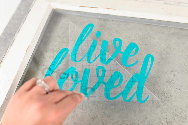 Applying transfer tape and vinyl to glass - How sure how to use transfer tape? Here's how to get professional results for your vinyl projects, plus tips and tricks for getting it perfect.