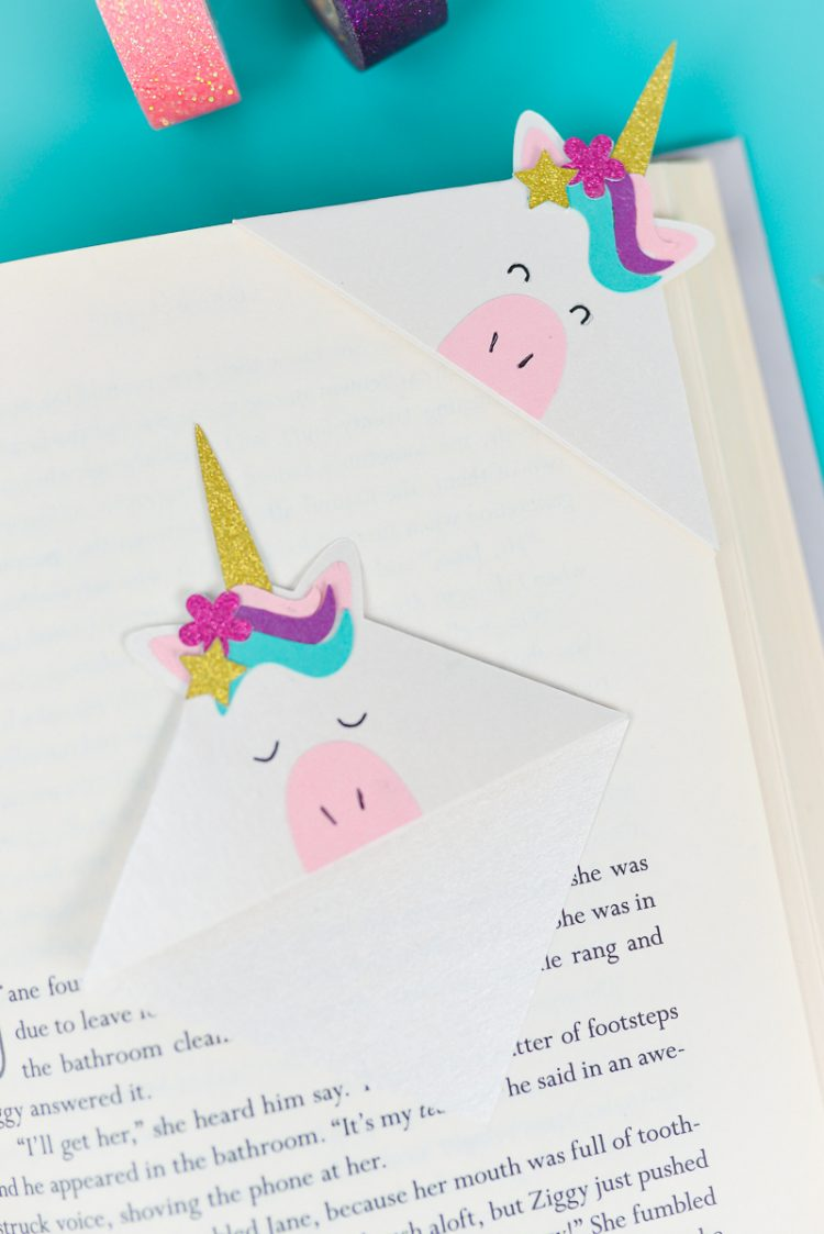 Unicorn Bookmark on Page Corner - Make these adorable little unicorn bookmarks! The perfect craft for any time you're diving into a particularly whimsical book. A FREE SVG and DXF download.