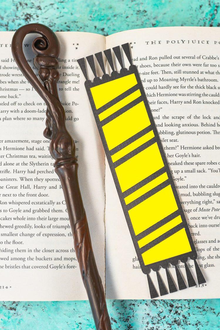 Hogwarts house bookmarks on book - Slytherin