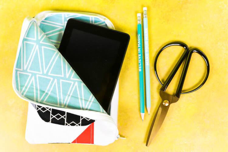 Use your Cricut Maker to cut and mark sewing patterns! Then sew this handy case for your tablet or Kindle, with an easy wrap-around zipper and exterior pocket for your earbuds or other accessories.