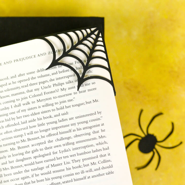 Make these clever corner Halloween bookmarks! The candy corn and spider web bookmarks are perfect for any time you're diving into a particularly spooky book. A FREE SVG and DXF download.
