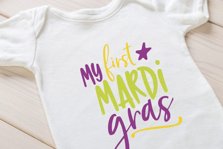 """Cute """"My First Mardi Gras"""" Onesie. Grab your beads and your king cake -- it's time for Mardi Gras! Use these Mardi Gras SVG files to make cute shirts, tumblers, and tote bags to celebrate Fat Tuesday!"""
