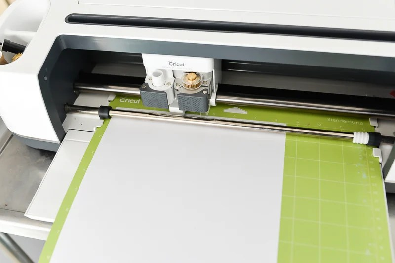 Mat inside the machine with white paper