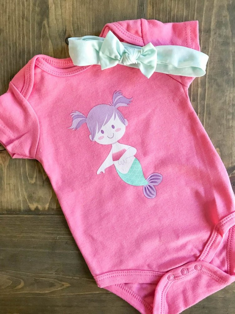Mermaid Onesie | Dress your littles in style with these DIY baby onesies! Your Cricut makes these baby favorites easy to put together—and they are perfect for baby showers and newborn gifts!