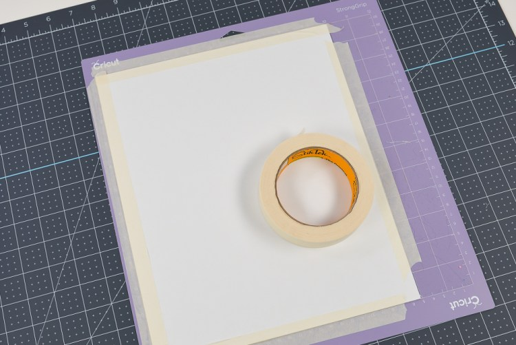 Tape all four edges of your matboard to the mat