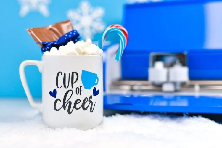 Looking for a sweet homemade gift to give this Christmas? This hot cocoa mug gift is perfect for almost everyone on your list! Easily make custom gifts like this using your Cricut Explore Air 2, now in gorgeous Cobalt!