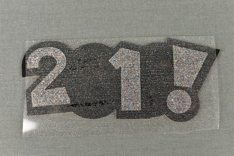 Layer glitter vinyl on top of regular iron on vinyl