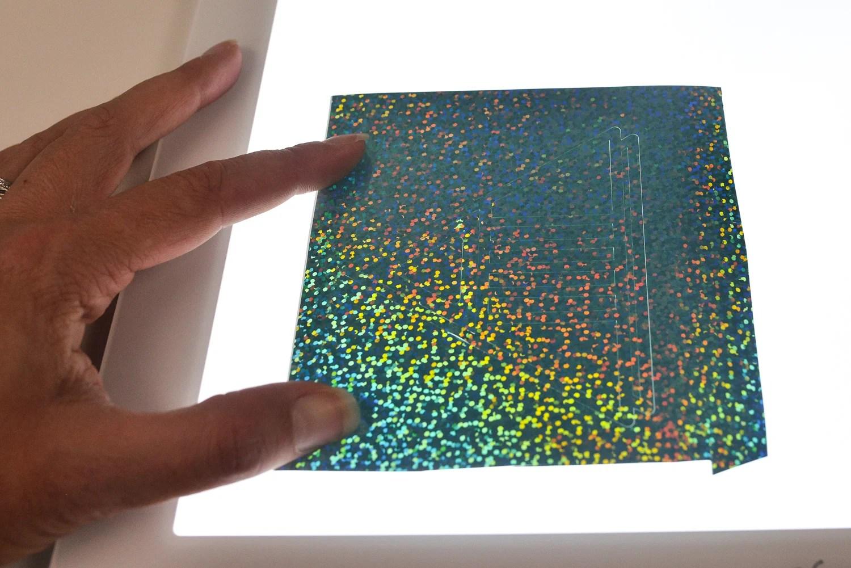 Weeding holographic vinyl with the Cricut Brightpad