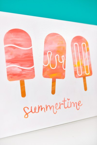 Create bright unique artwork using this hot mess canvas technique! Make this cute popsicle artwork using canvas, paint, and your Cricut or other cutting machine—the fun part is, every hot mess canvas is different!