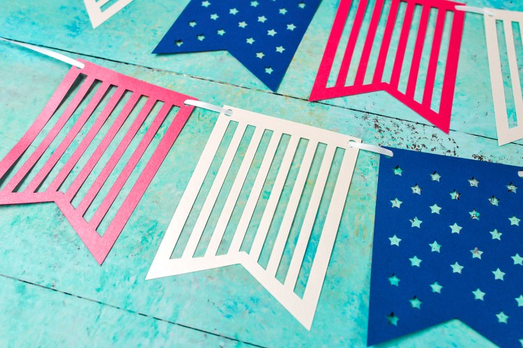 Make decorating for your patriotic party easy with this 4th of July paper banner—just cut using your Cricut or other cutting machine! Get the free cut file and instructions to make this banner for any 4th of July party.